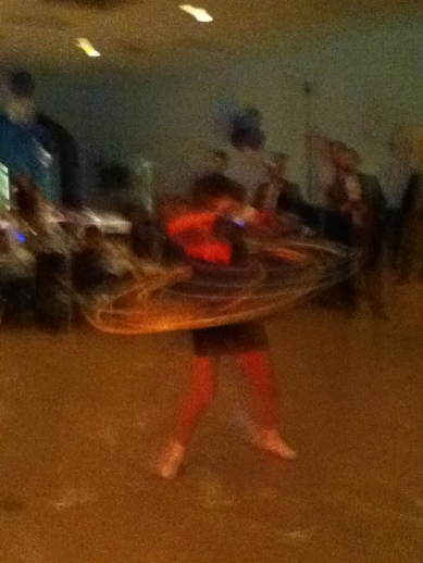 semi-finals at a Bat Mitzvah Hula Hoop Contest. How long can she spin 12 hoops at once?