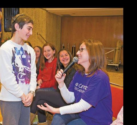 Matthew Berg, 11, of Farmington talks with Re-becca Schlussel of West Bloomfield about the proper way to say thank you after a bar mitzvah.