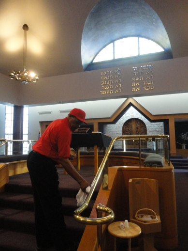Murphy Ealy shines the brass on the bimah at Congregation Beth Ahm.